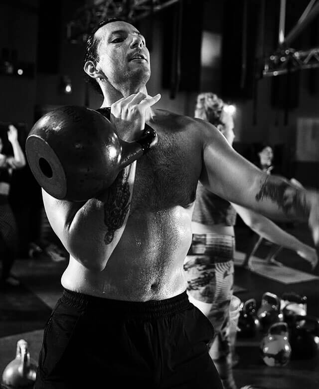 A man lifting kettlebells